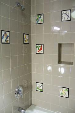 Hand painted tile shower installation using Besheer Art Tile and grey field tiles by Daltile