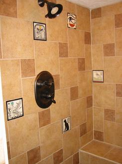 Hand Painted Besheer Art Tile with Egyptian Designs Installed in a Bathroom Shower